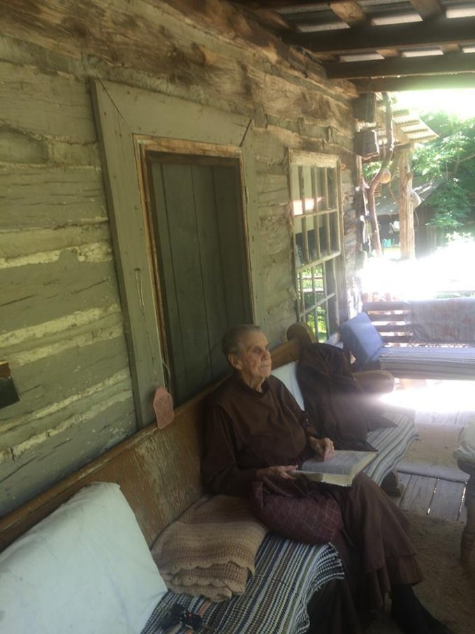 Off grid at 88 sitting at her cabin's porch