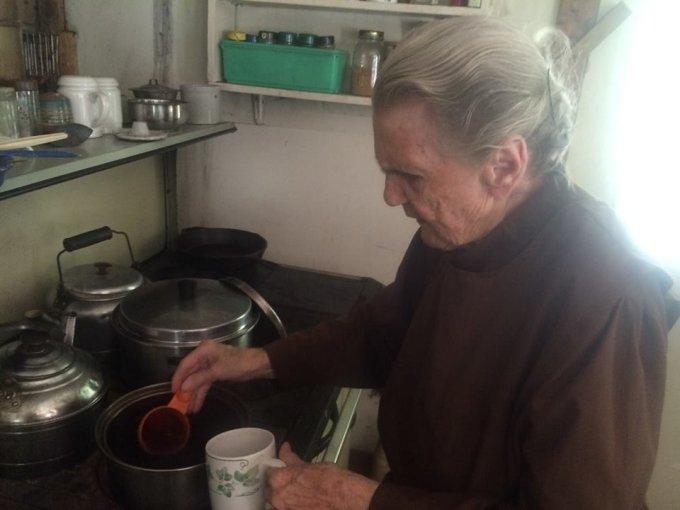 Off grid at 88 making tea on wood stove