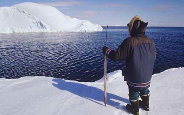Inuit watching the iceberg