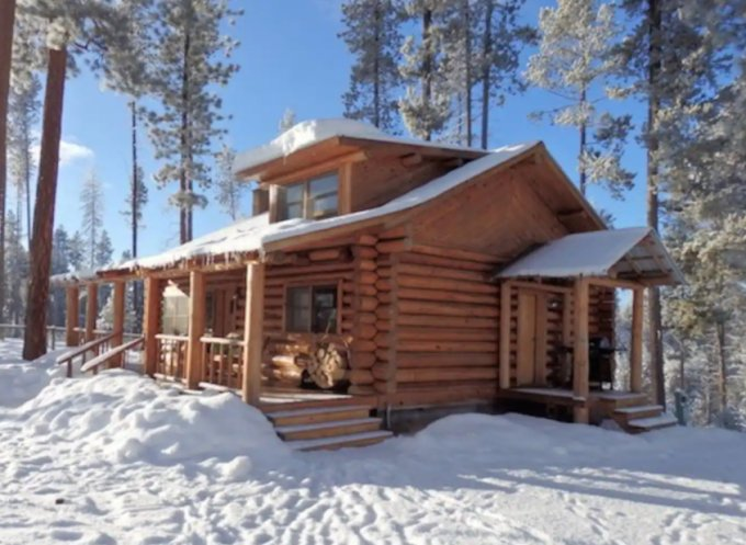 Rustic log cabin in the winter