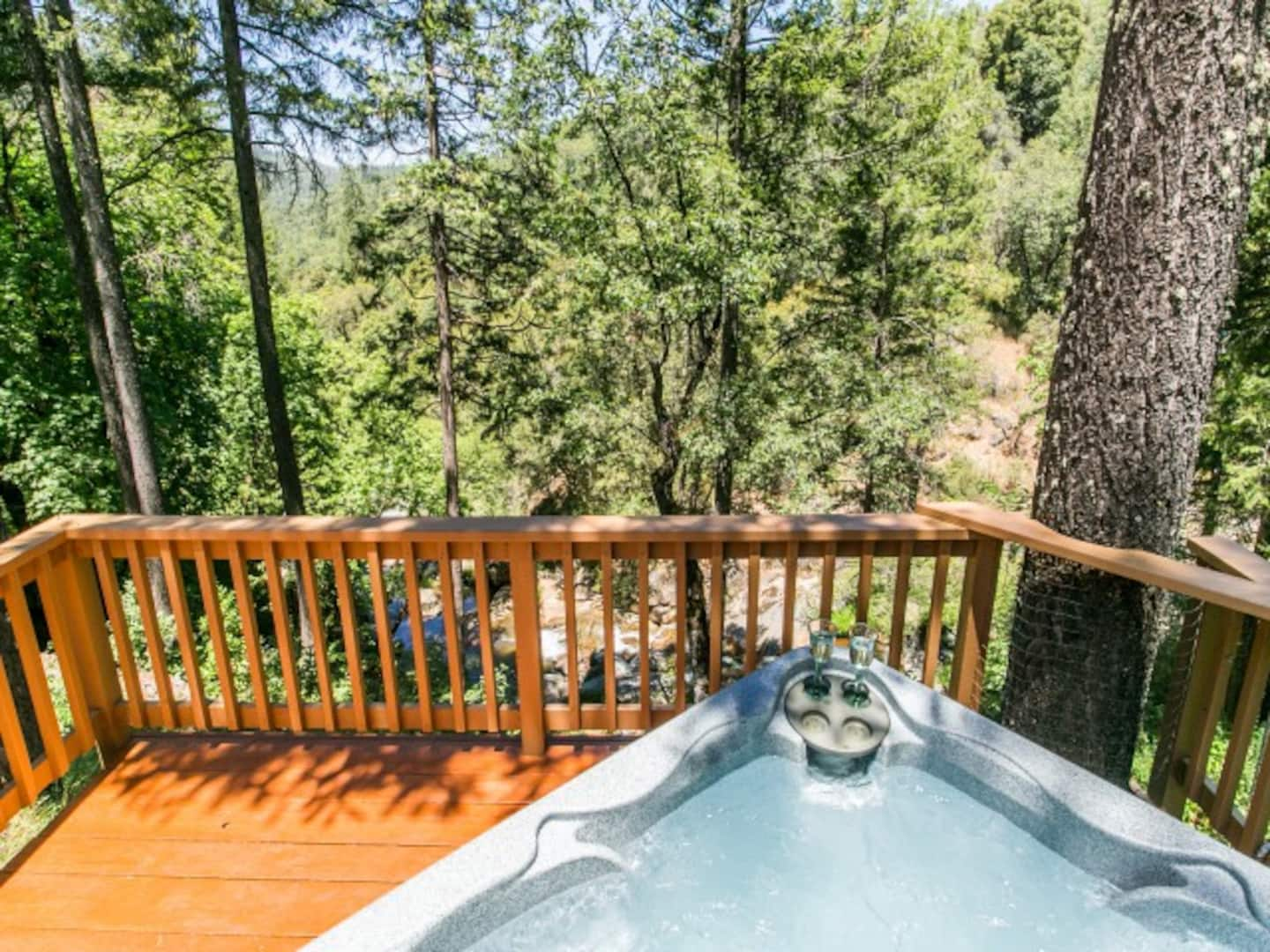 Woodland cabin deck with hot tub